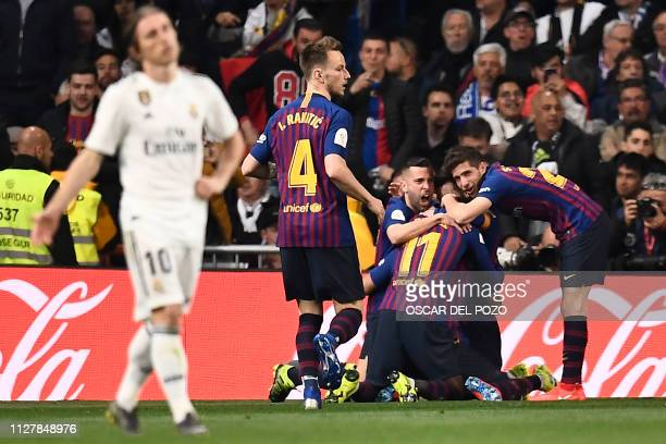 TOPSHOT Barcelona players celebrate their opening goal during the Spanish Copa del Rey semifinal second leg football match between Real Madrid and...