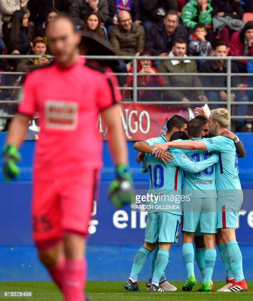 Barcelona players celebrate their opening goal during the Spanish league football match between SD Eibar and FC Barcelona at the Ipurua stadium in...