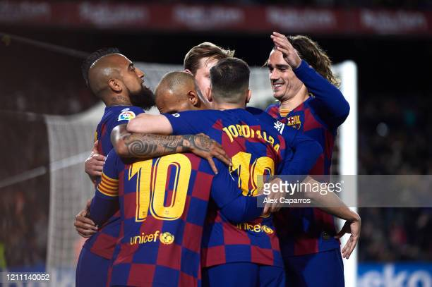 Barcelona players celebrate their opening goal scored by Lionel Messi during the Liga match between FC Barcelona and Real Sociedad at Camp Nou on...