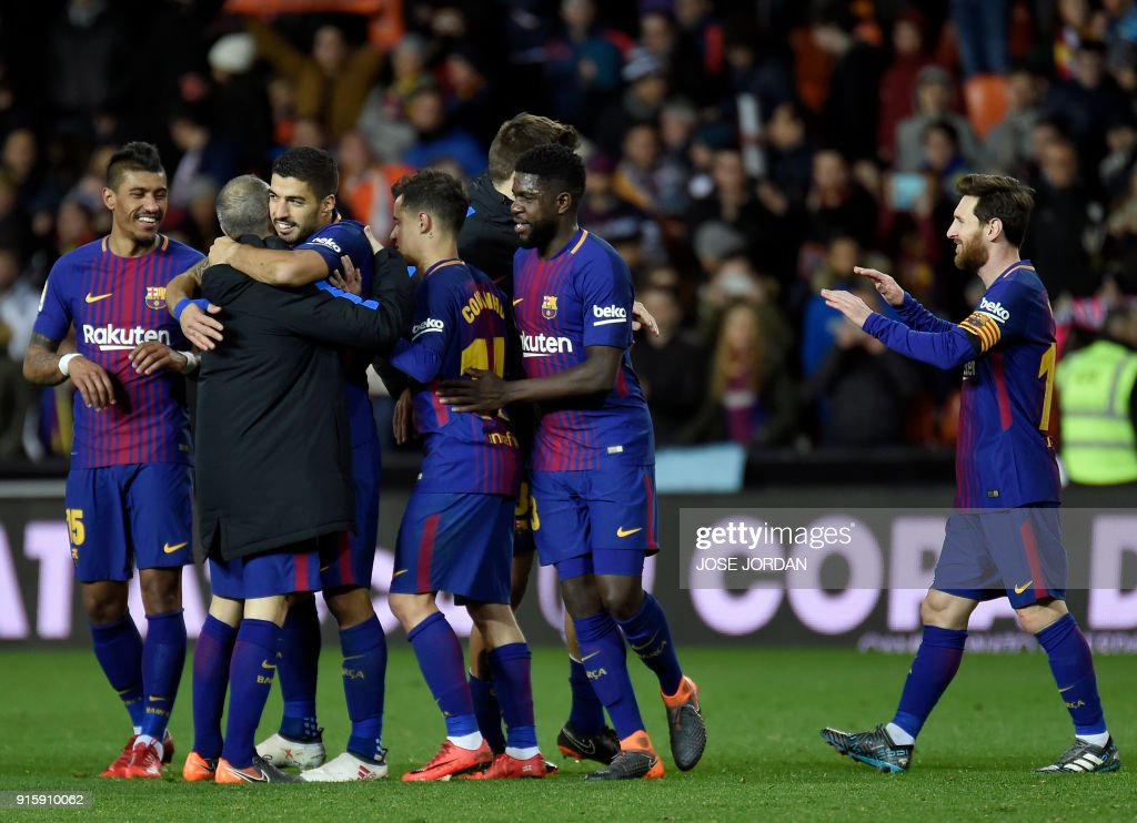 Barcelona players celebrate their qualification for the final match after the Spanish 'Copa del Rey' (King's cup) second leg semi-final football match between Valencia CF and FC Barcelona at the Mestalla stadium in Valencia on February 8, 2018. /
