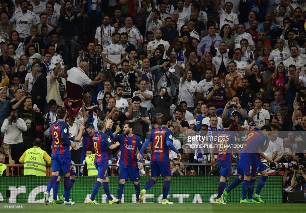 Barcelona players celebrate their second goal during the Spanish league football match Real Madrid CF vs FC Barcelona at the Santiago Bernabeu stadium in Madrid on April 23, 2017. /