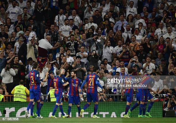 Barcelona players celebrate their second goal during the Spanish league football match Real Madrid CF vs FC Barcelona at the Santiago Bernabeu...