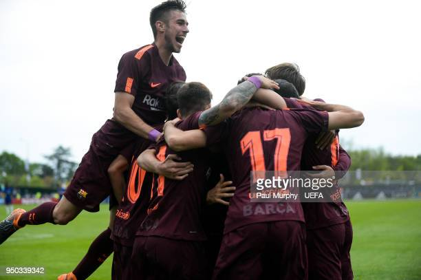 Barcelona players celebrate their side's first goal during the UEFA Youth League Final between Chelsea FC and FC Barcelona at Colovray Sports Centre...