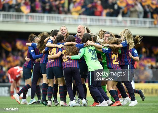 Barcelona players celebrate their win at the end of the UEFA Women's Champions League semifinal second leg football match between Barcelona and...