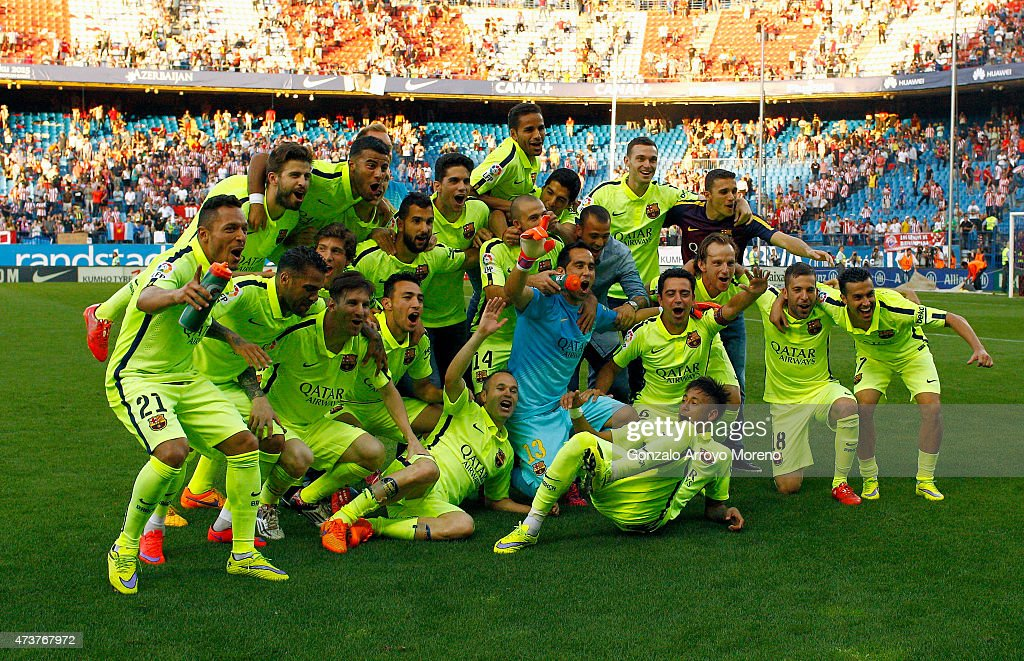 Barcelona players celebrate winning the title after the La Liga match between Club Atletico de Madrid and FC Barcelona at Vicente Calderon Stadium on May 17, 2015 in Madrid, Spain. Barcelona are champions after a 1-0 victory.