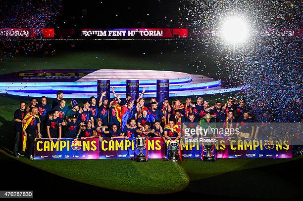 Barcelona players celebrate with La Liga Copa del Rey and Champions League trophies during their victory parade after winning the UEFA Champions...