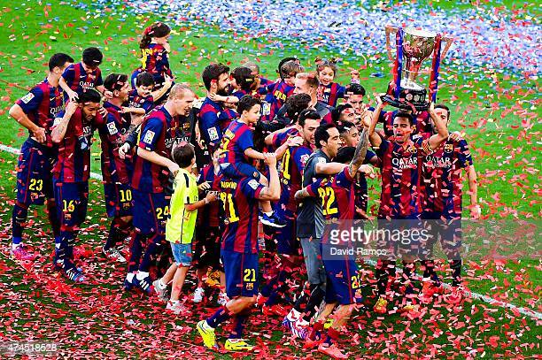 La liga pictures and photos getty images barcelona players celebrate with la liga trophy at the end of the la liga match between stopboris Gallery