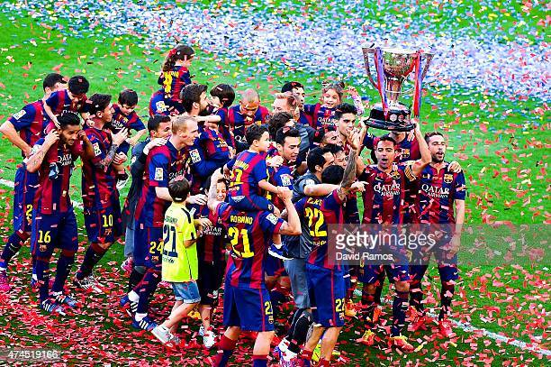 Barcelona players celebrate with La Liga trophy at the end of the La Liga match between FC Barcelona and RC Deportivo de la Coruna at Camp Nou on May...