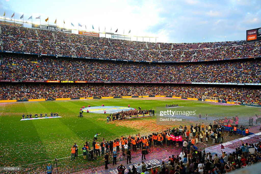 FC Barcelona players celebrate with La Liga trophy at the end of the La Liga match between FC Barcelona and RC Deportivo de la Coruna at Camp Nou on May 23, 2015 in Barcelona, Spain.