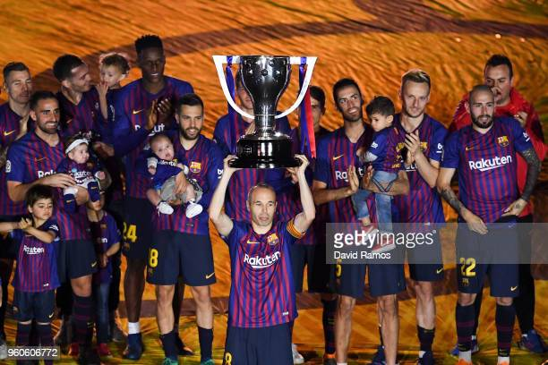 Barcelona players celebrate with La Liga trophy at the end of the La Liga match between Barcelona and Real Sociedad at Camp Nou on May 20 2018 in...