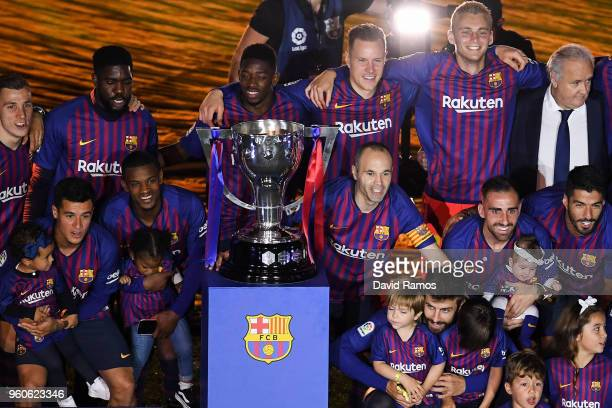 Barcelona players celebrate with La Liga trophy at the end of the La Liga match between Barcelona and Real Sociedad at Camp Nou on May 20, 2018 in...