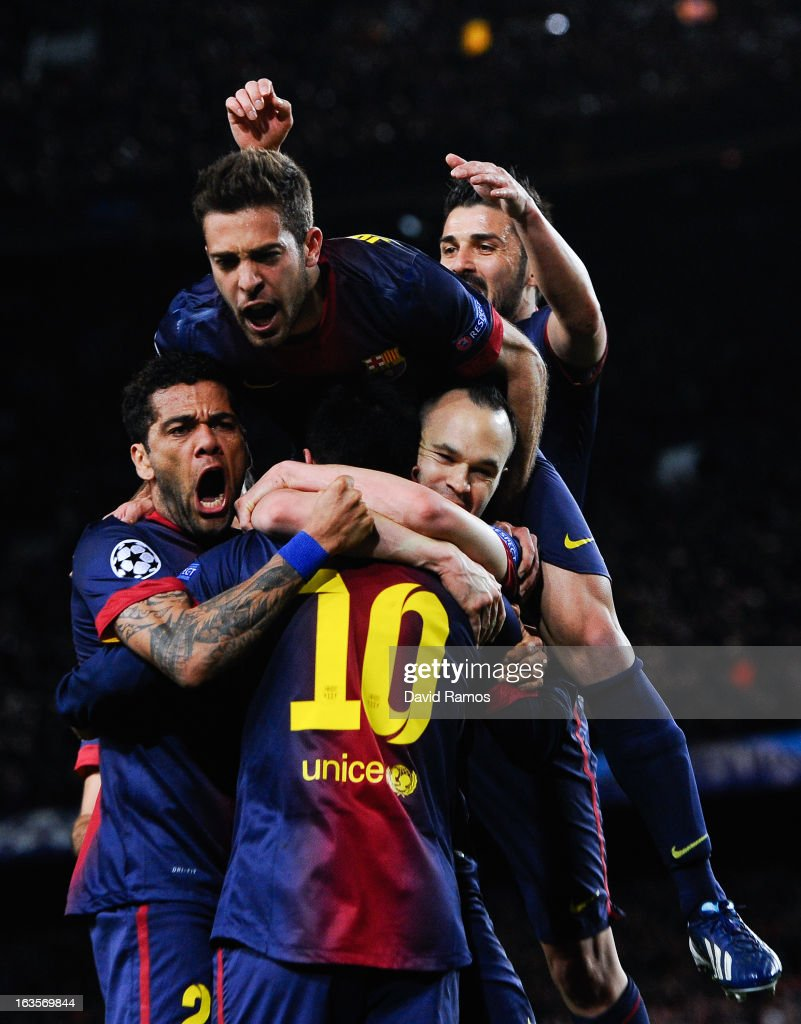 FC Barcelona players celebrate with Lionel Messi of FC Barcelona after he scored his team's second goal during the UEFA Champions League round of 16 second leg match between FC Barcelona and AC Milan at the Camp Nou Stadium on March 12, 2013 in Barcelona, Spain.