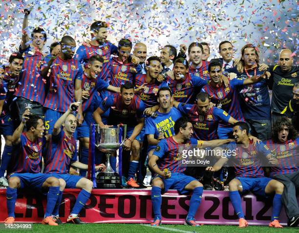 Barcelona players celebrate with the Copa del Rey trophy after beating Athletic Bilbao 30 during the Copa del Rey Final at Vicente Calderon Stadium...