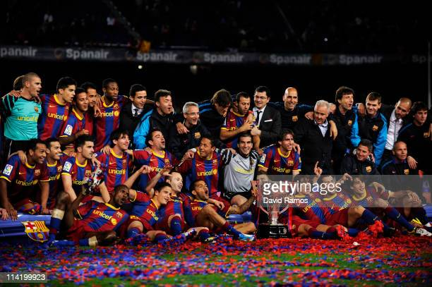 Barcelona players celebrate with the La Liga trophy after the La Liga match between Barcelona and Deportivo La Coruna at Camp Nou Stadium on May 15...