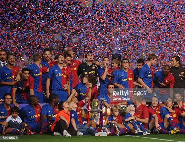 Barcelona players celebrate with the La Liga trophy after the La Liga match between Barcelona and Osasuna at the Nou Camp stadium on May 23, 2009 in...