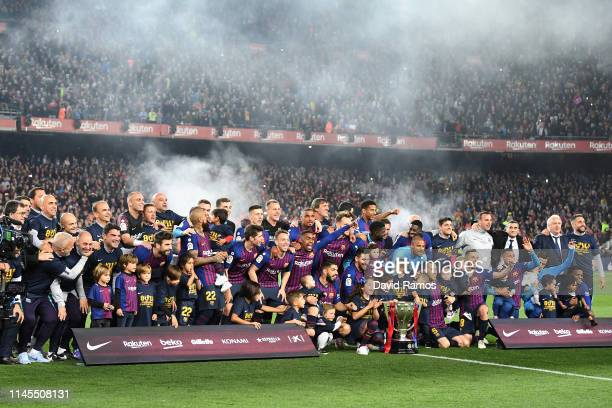 Barcelona players celebrate with the La Liga trophy as they win La Liga following their victory in during the La Liga match between FC Barcelona and...