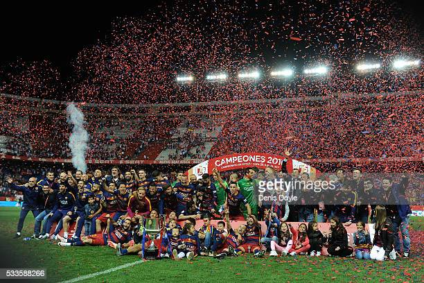 Barcelona players celebrate with the trophy after beating Sevilla 20 in the Copa del Rey Final between Barcelona and Sevilla at Vicente Calderon...