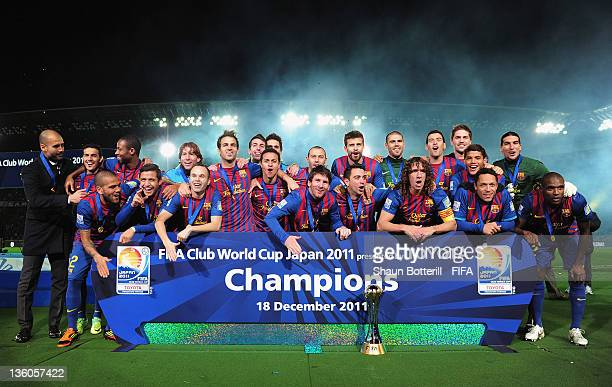 Barcelona players celebrate with the trophy after the FIFA Club World Cup Final match between Santos and Barcelona at the Yokohama International...