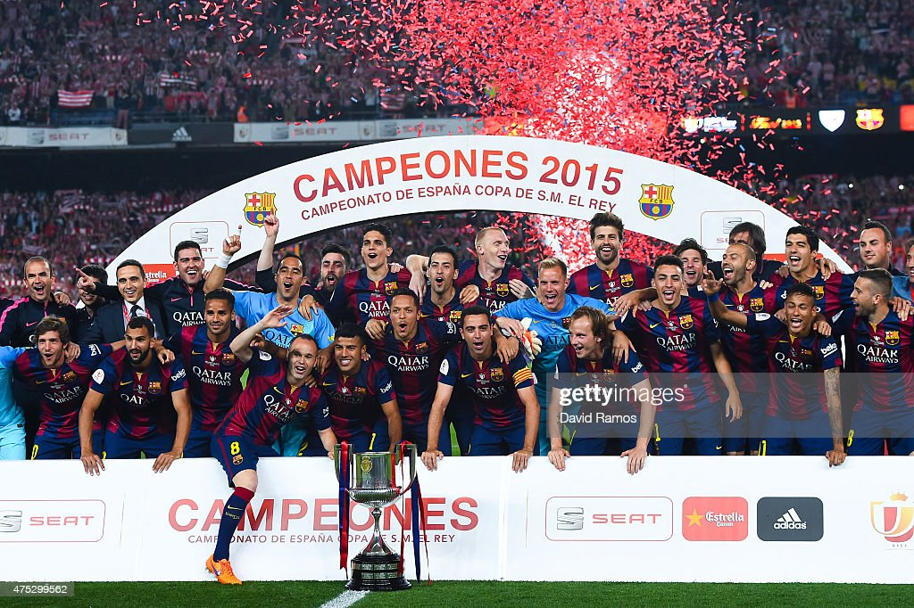 FC Barcelona players celebrate with the trophy after winning the Copa del Rey Final match between FC Barcelona and Athletic Club at Camp Nou on May 30, 2015 in Barcelona, Spain.