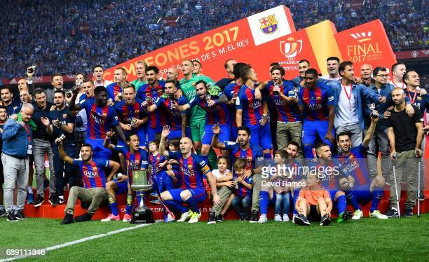 Barcelona players celebrate with the trophy after winning the Copa Del Rey Final between FC Barcelona and Deportivo Alaves at Vicente Calderon...