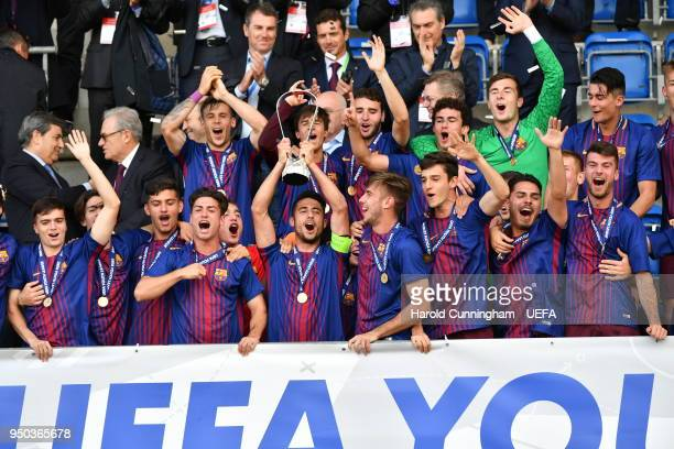 Barcelona players celebrate with the trophy following the UEFA Youth League Final between Chelsea FC and FC Barcelona at Colovray Sports Centre on...