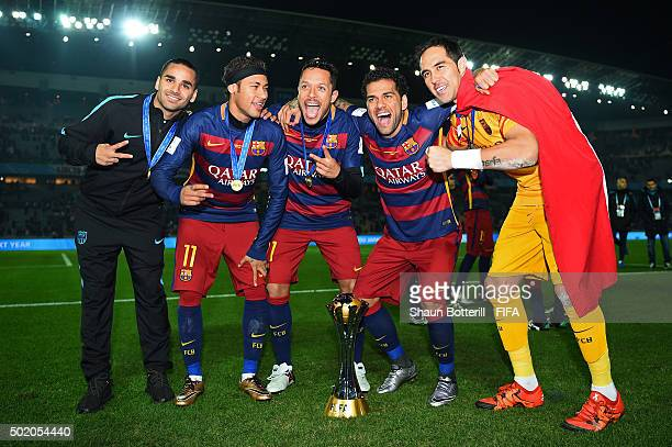 Barcelona players celebrate with the trophy following their team's 30 victory during the FIFA Club World Cup Final between River Plate and FC...