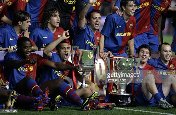 Barcelona players celebrate with the trophy for the Spanish league title 2009 after their Spanish League football match against Osasuna on May 23...