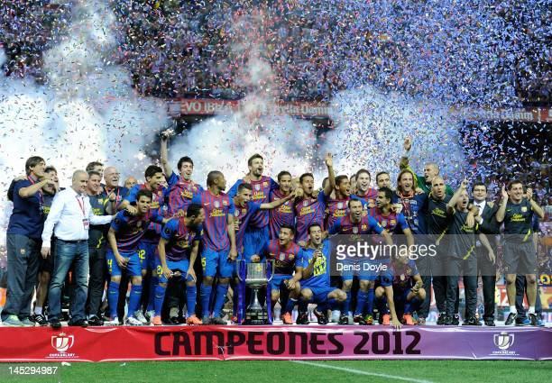 Barcelona players celebrate with their trophy after beating Athletic Bilbao 30 during the Copa del Rey Final at Vicente Calderon Stadium on May 25...