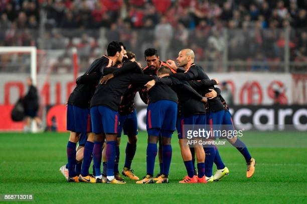 Barcelona players concentrate on the pitch prior to the UEFA Champions League group D football match between FC Barcelona and Olympiakos FC at the...