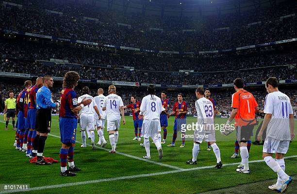 Barcelona players form a guard of honour for La Liga champions Real Madrid before the start of the La Liga match between Real Madrid and Barcelona at...