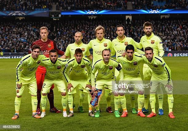 Barcelona players goalkeeper MarcAndre ter Stegen midfielders Javier Mascherano Ivan Rakitic Sergio Busquets Burgos and defender Gerard Pique and...