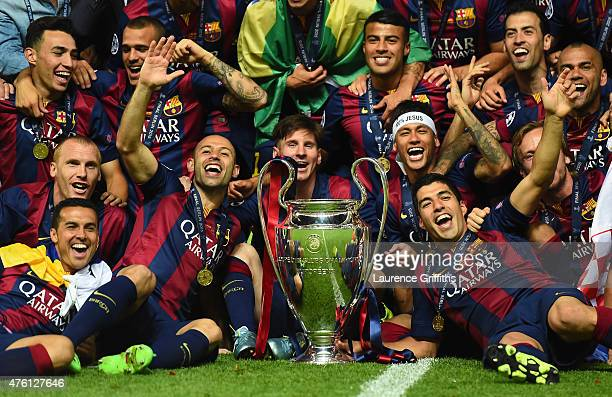 Barcelona players including Javier Mascherano, Lionel Messi, Neymar and Luis Suarez celebrate victory with the trophy after the UEFA Champions League...
