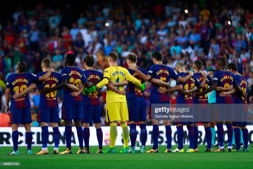 FC Barcelona players line up to observe a minute's silence in memory of victims of the terrorist attack in Barcelona this week prior to start the La Liga match between FC Barcelona and Real Betis Balompie at Camp Nou stadium on August 20, 2017 in Barcelona, Spain.