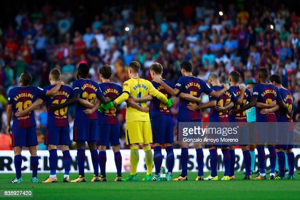 Barcelona players line up to observe a minute's silence in memory of victims of the terrorist attack in Barcelona this week prior to start the La...