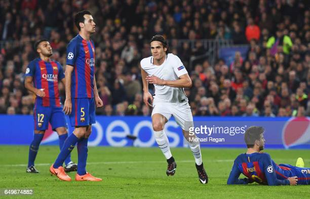Barcelona players look dejected as Edinson Cavani of Edinson Cavani of PSG celebrates as he scores their first goal during the UEFA Champions League...