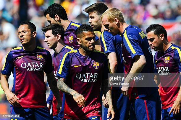 Barcelona players look on during the warm up priot to the La Liga match between FC Barcelona and Valencia CF at Camp Nou on April 18 2015 in...