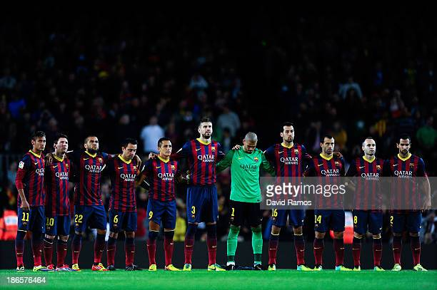 Barcelona players observe a minute of silence of goalkeeper Nil Marin of Girona 'B' during the La Liga match between FC Barcelona and RCD Espanyol at...