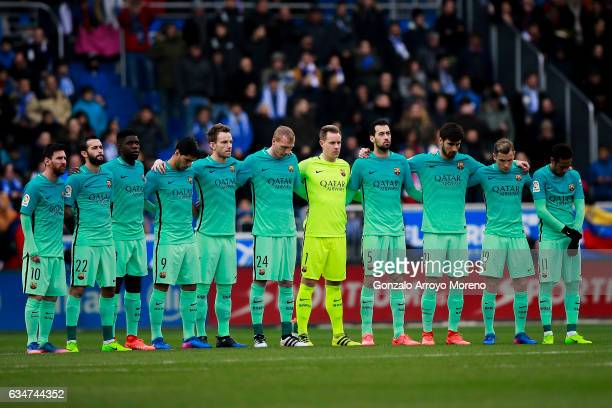 FC barcelona players observe one minute of silence in honor of Angola victims prior to start the La Liga match between Deportivo Alaves and FC...