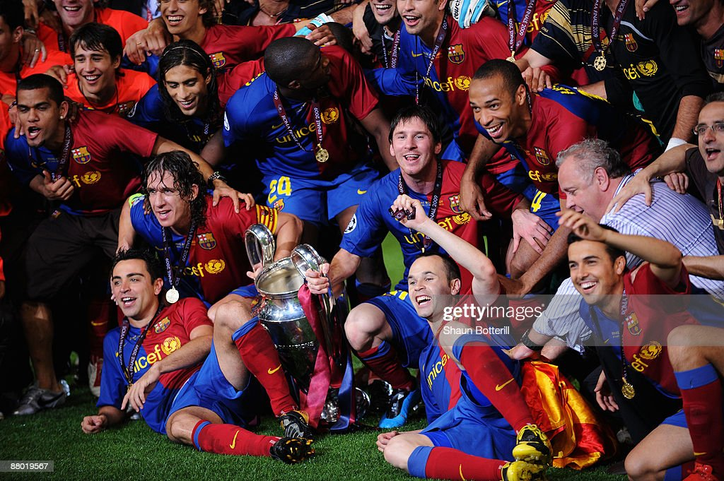 Barcelona players pose in front of the trophy after they celebrate winning the UEFA Champions League Final match between Barcelona and Manchester United at the Stadio Olimpico on May 27, 2009 in Rome, Italy. Barcelona won 2-0.
