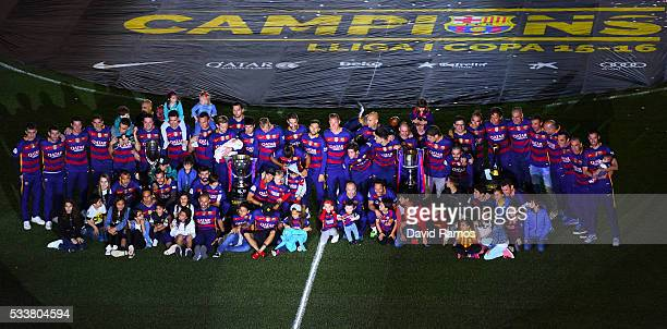 Barcelona players pose with La Liga and Copa del Rey trophies at the Camp Nou stadium on May 23 2016 in Barcelona Spain