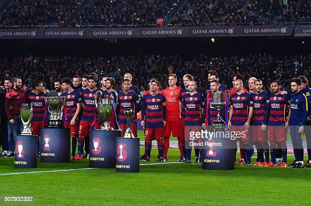 Barcelona players pose with La Liga UEFA Champions League Copa del Rey UEFA Supercup and FIFA Club World Cup trophies prior to the La Liga match...