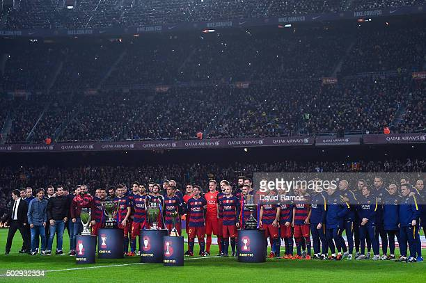 Barcelona players pose with La Liga UEFA Champions League Copa del Rey UEFA Supercup and FIFA Club World Cup trophies prior to the La Liga match...