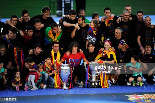 Barcelona players pose with the La Liga Tropy and the UEFA Champions League trophy during the celebrations after winning the UEFA Champions League...