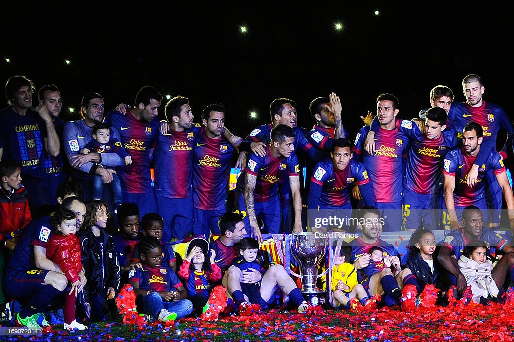 FC Barcelona players pose with the trophy during the celebration after winning the Spanish League after the La Liga match between FC Barcelona and Real Valladolid CF at Camp Nou on May 19, 2013 in Barcelona, Spain.