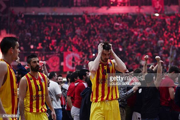 Barcelona players react after they lost to Olympiakos Piraeus during their play off Euroleague basketball match at the Peace and Friendship stadium...