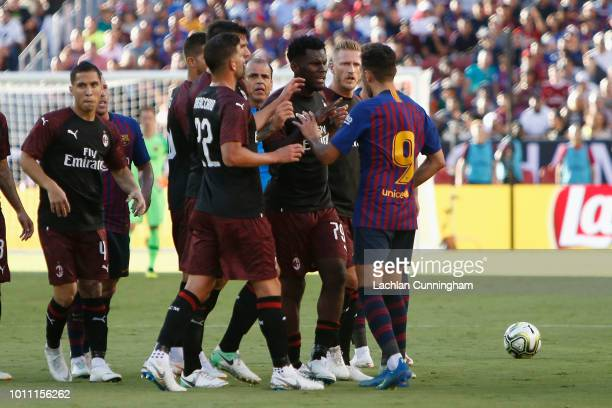 Barcelona players remonstrate with AC Milan players after Ricky Puig of FC Barcelona was fouled by Franck Kessié of AC Milan during the International...