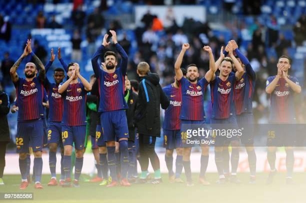Barcelona players show fans their appreciation after the La Liga match between Real Madrid and Barcelona at Estadio Santiago Bernabeu on December 23...