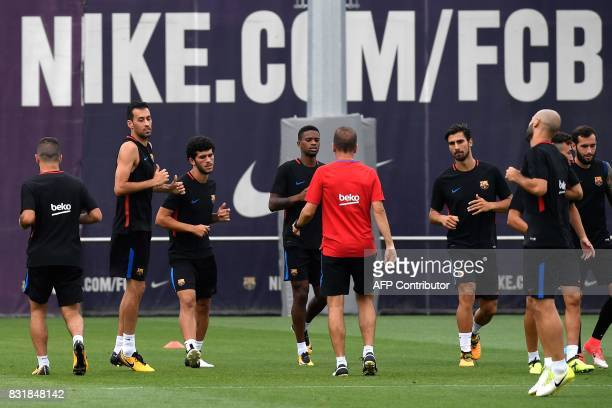 Barcelona players take part in a training session at the Sports Center FC Barcelona Joan Gamper in Sant Joan Despi near Barcelona on August 15 on the...