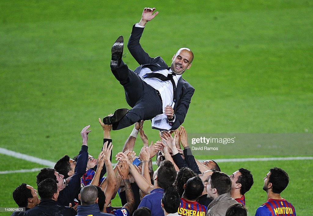 FC Barcelona players throw Josep Guardiola their head coach into the air at the end of the La Liga match between FC Barcelona and RCD Espanyol at Camp Nou on May 5, 2012 in Barcelona, Spain. This is Guardiola's last match.
