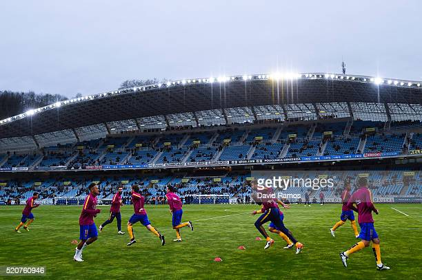 Barcelona players warm up prior to the La Liga match between Real Sociedad de Futbol and FC Barcelona at Estadio Anoeta on April 9 2016 in San...